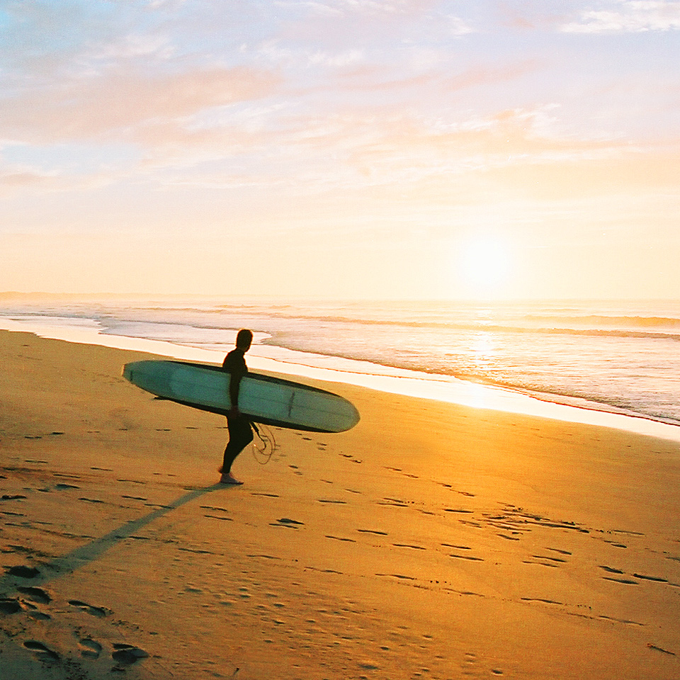 Ready to surf at sunrise